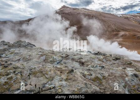 Hverir boiling mud area also called Hverarond near Reykjahlid town in the north of Iceland. - Stock Photo