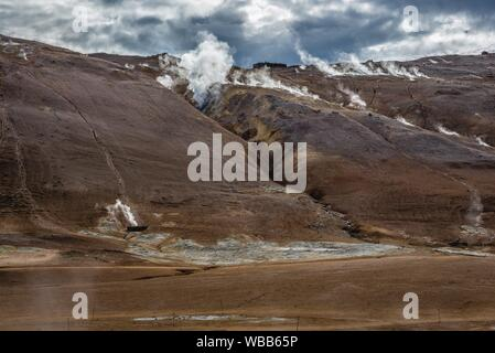 Namafjall mountain seen from Hverir boiling mud area also called Hverarond near Reykjahlid town in the north of Iceland. - Stock Photo