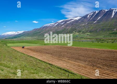 Plowed field near Vikurskard mountain pass in norther Iceland. - Stock Photo