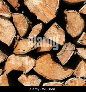 Background texture. Chopped firewood abstract pattern. Wood stack. Square composition. - Stock Photo