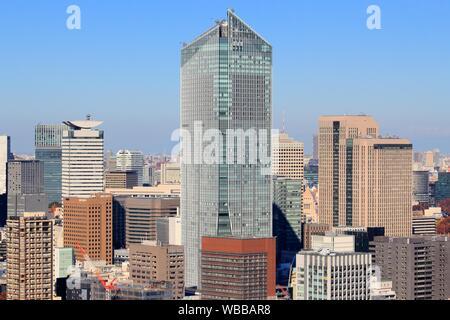 TOKYO, JAPAN - DECEMBER 2, 2016: Toranomon Hills Mori Tower skyscraper in Minato Ward, Tokyo. The building was designed by Nihon Sekkei and constructe - Stock Photo