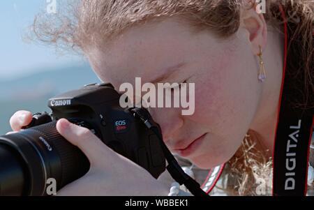 Young Canon EOS Rebel - Stock Photo