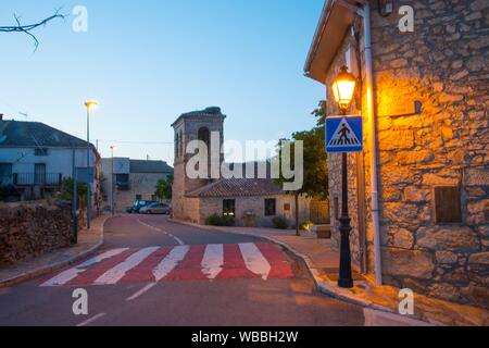 Street and church, night view. Piñuecar, Madrid province, Spain. - Stock Photo
