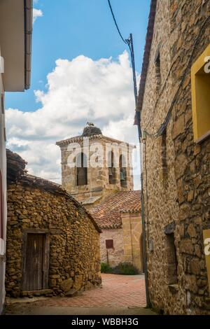 Street and church. Piñuecar, Madrid province, Spain. - Stock Photo