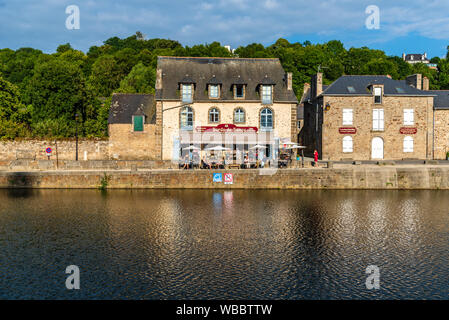 Dinan, France - July 23, 2018: View of a typical restaurant in the port of the town on the river Rance at sunset, French Brittany - Stock Photo