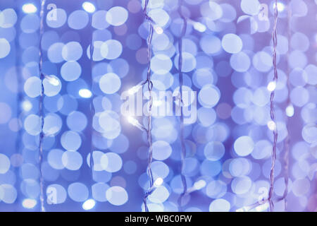 Soft colorful bokeh background. Luminous garlands of electric lights. Copy space to add text. Saturated colors. Blurry abstraction. Gentle tone.