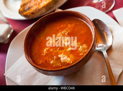 Traditional Castilian peasant style garlic soup served in clay bowl - Stock Photo