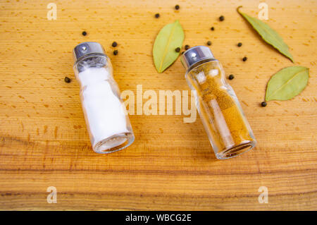 Cutlery for spices on a wooden cutting board. Place for writing text. - Stock Photo