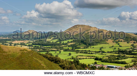Shropshire hills viewed from the Long Mynd. The Wrekin, left. The Lawley, Centre and Caer Caradoc,hill right. Church Stretton, England, UK. - Stock Photo