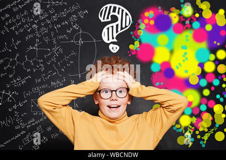 Kid with question marks on background with science and arts scetch - Stock Photo