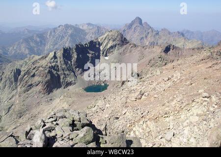 Lac de Cinto and Paglia Orba from Monte Cinto sidepeak, France, Corsica - Stock Photo