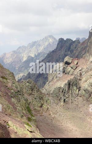 View across Col de Maures from rock window of Capu Tafunatu, France, Corsica - Stock Photo