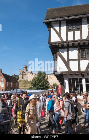 Crowds gather in Castle Hill market square for the annual Steampunk Festival at historic city of Lincoln, Lincolnshire, UK - Stock Photo
