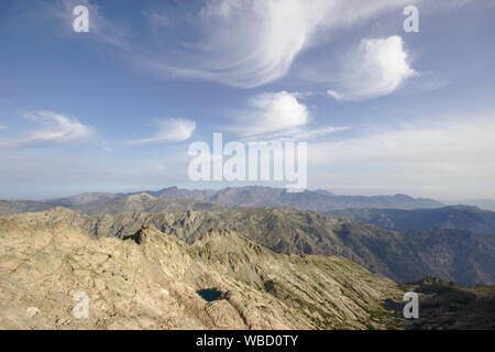 Clouds over Corsica, view from Monte Renoso to Paglia Orba and Monte Cinto, France, Corsica - Stock Photo