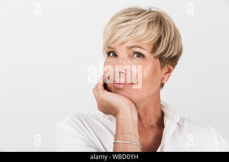Portrait closeup of middle-aged woman with short blond hair looking at camera isolated over white background in studio - Stock Photo