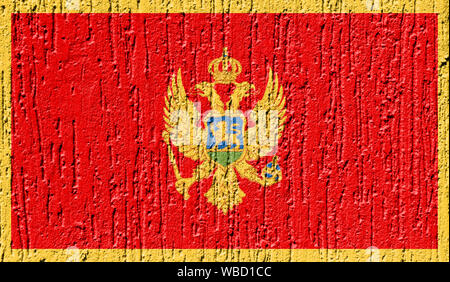 Flag of Montenegro close up painted on a cracked wall - Stock Photo