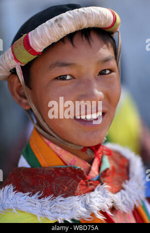 Young man with traditional dress at the inaugural procession of the annual Ladakh Festival in Leh, India. - Stock Photo