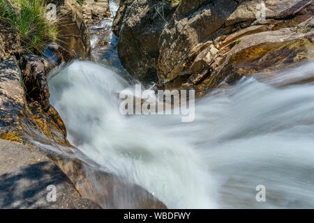 Rushing Creek - Mountain creek rushing down a narrow rocky canyon at top of Chasm Falls, Rocky Mountain National Park, CO, USA. - Stock Photo