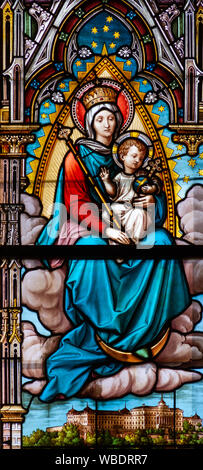 Stained glass window depicting the Virgin Mary with the Infant Jesus and King Saint Stephen I. in the Cathedral of St Elisabeth (Dom Svatej Alzbety). - Stock Photo