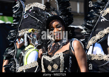 London, UK . 26th Aug, 2019. Thousands attend the first day of the Notting Hill Carnival in west London on August 26, 2019. Nearly one million people are expected by the organizers regradless of the wet weather Sunday and Monday in the streets of west London's Notting Hill to celebrate Caribbean culture at a carnival considered the largest street demonstration in Europe, London, UK. Credit: Picture Capital/Alamy Live News - Stock Photo
