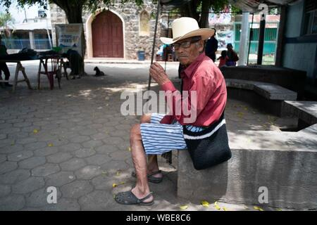 Streets scenes in the mountain village of Cerro de Oro, a small impoverished town on the north shore of Lake Atitlan, Solola in Guatemala's central highlands. The area is a popular destination for hikers climbing nearby volcanoes. - Stock Photo