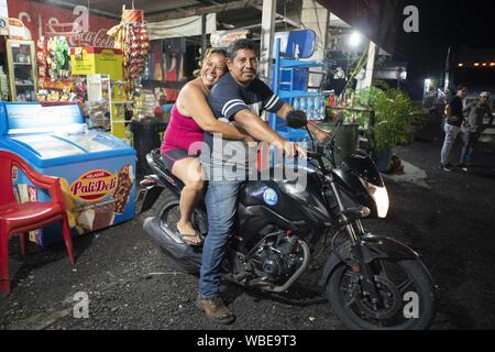 August 8, 2019, Cocales, Suchitepequez, Guatemala: Night scenes along highway CA-2 at Cocales, Suchitepequez Guatemala in the summer of 2019. The village is about 110 km west of Guatemala City on the highway to Lake Atitlan. (Credit Image: © Bob Daemmrich/ZUMA Wire) - Stock Photo