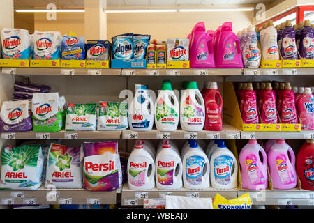 Izmir, Turkey - Aug 23rd, 2019: Variety washing-powder; soap powder; detergent Washing-powder, cleaning products on supermarket shelf. Mintax, Calgon. - Stock Photo