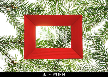 Creative Christmas composition made of green fir tree branches on white background, isolated. - Stock Photo