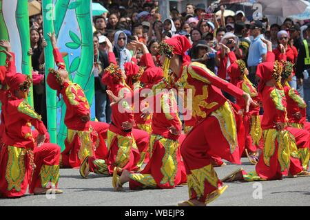 Davao City, Philippines-August 2014: Street dancers in colorful costumes at the Kadayawan festival.  Kadayawan is celebrated August each year to give - Stock Photo