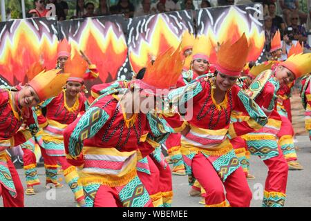 Davao City, Philippines-August 2014: Street dancers performing for the judges and crowds. Kadayawan is celebrated August each year to give thanks for - Stock Photo