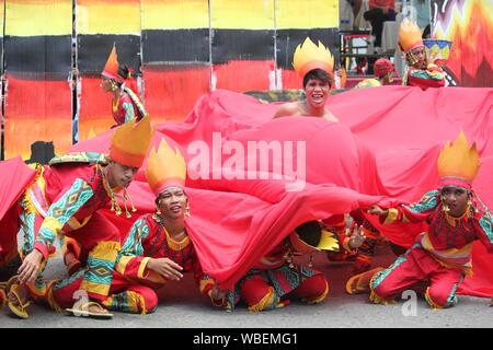 Davao City, Philippines-August 2014: Street dancers in colorful props and costumes impress the crowds at the Kadayawan festival.  Kadayawan is celebra - Stock Photo