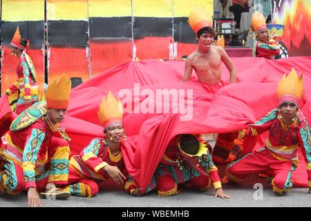 Davao City, Philippines-August 2014: Street dancers in colorful props and costumes at the Kadayawan festival. Kadayawan is celebrated August each year - Stock Photo