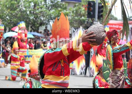 Davao City, Philippines-August 2014: Street dancers at a Kadayawan festival presentation. Kadayawan is celebrated August each year to give thanks for - Stock Photo