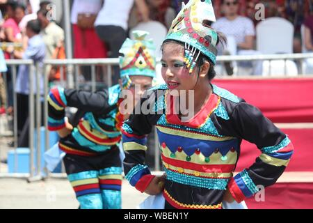 Davao City, Philippines-August 2014: Street dancers at the Kadawayan festival parade. Kadayawan is celebrated August each year to give thanks for life - Stock Photo