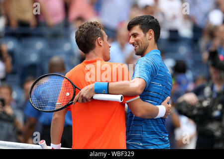 New York, USA. 26th Aug, 2019. Novak Djokovic (R) of Serbia talks to Roberto Carballes Baena of Spain after the men's singles first round match at the 2019 US Open in New York, the United States, Aug. 26, 2019. Credit: Li Muzi/Xinhua/Alamy Live News - Stock Photo