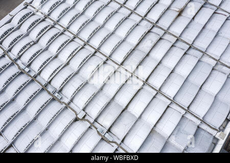 metal roof of warehouse or factory. urban industrial district, aerial top view - Stock Photo