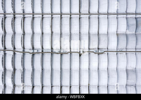 metal roof of an factory building. industrial background. aerial top view - Stock Photo