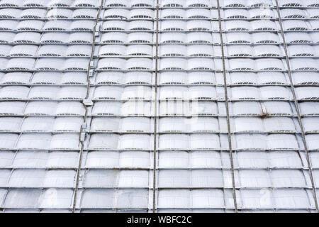 aerial top view of modern industrial roof of warehouse or factory building - Stock Photo