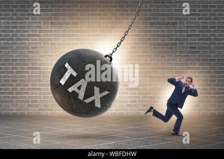 The businessman running away from high taxes - Stock Photo