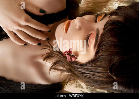 Close-up Of Young Woman Lying Down - Stock Photo