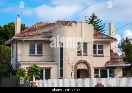Streamline Moderne or Ocean Liner style home, a variation on 1930s Art Deco styles in suburban Melbourne, Victoria, Australia - Stock Photo