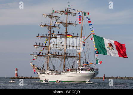 PORT WARNEMÜNDE, GERMANY : Sail training vessel 'Cuauhtemoc' of the Mexican Navy is passing the light beacon on August 11, 2019 - Stock Photo