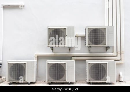 There are many air compressor machine part of air conditioner system installing at wall. - Stock Photo