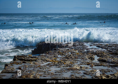 Scenic View Of Sea Waves Splashing Against Sky - Stock Photo
