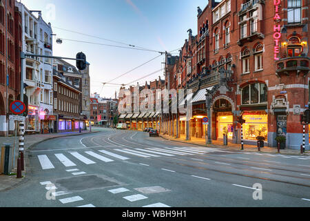 Amsterdam-Netherlands, August 18, 2017 : Street scene with modern tram in Amsterdam, tram is one of the quickest ways to get into and around the city - Stock Photo