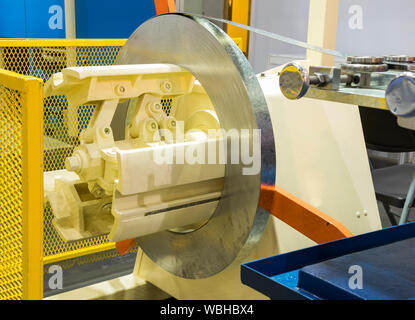 stainless steel coil roll in machine ; ready to use in cold rolling process ; Focus at raw material - Stock Photo
