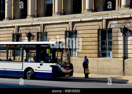 Bus stopping to pick up male passenger on Alfred Gelder Street, Hull, East Yorkshire, England UK - Stock Photo