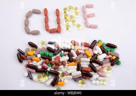 Directly Above Of Text Made From Capsules On Gray Background - Stock Photo