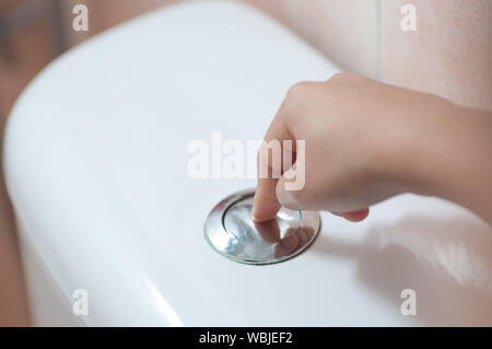 Cropped Hand Of Woman Pressing Button - Stock Photo