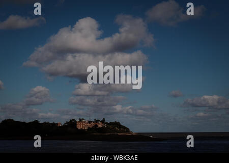 Bawdsey Manor In Front Of River Against Cloudy Sky At Dusk - Stock Photo